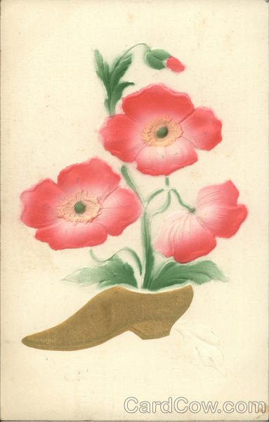 Pink flowers and wooden shoe