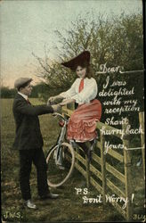 Woman hopped off bicycle sitting astride fence holding her beau's hands.
