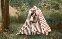 Two Couples in a Red and White Striped Tent