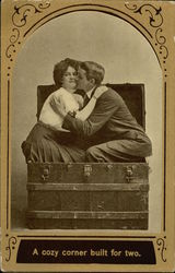 Woman and Man Kissing while Sitting in a Traveling Trunk