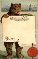 Bear holding sheet music