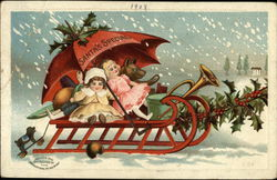 Toys in a Sleigh Being Pulled through Snow by Holly