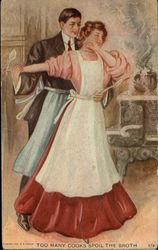 Couple Dancing in Kitchen Wearing Aprons