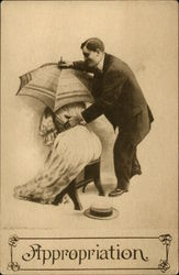 Woman Hiding Under Parasol Man With Hand on her Waist
