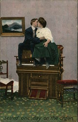 Couple kissing atop an organ