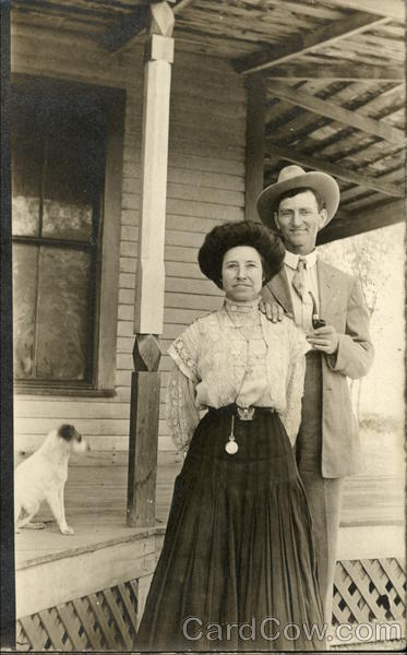 Couple Standing by Home with Dog Tempe Arizona