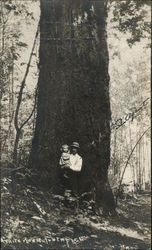 Man and Daughter by a Tree