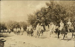 Women Riding Horses Along Street