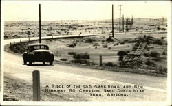 A Piece of the Old Plank Road and New Highway 80 Crossing Sand Dunes Near Yuma, Arizona