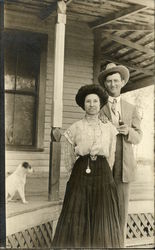 Couple Standing by Home with Dog Postcard