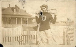 Woman Holding a Tennis Racket