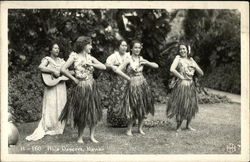 Hulu Dancers in Grass Skirts
