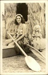 Hula Girls in Grass Skirts in Canoe