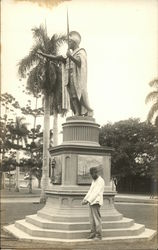 Man Standing Beside Statue of King Kamehameha