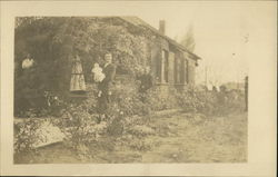 Man with Baby, People, Outside Ivy Covered Bungalow