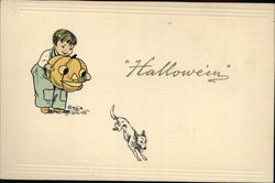 Boy Scaring Dog with Jack O'Lantern