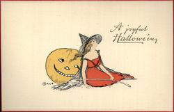 Witch Dressed in Red Leaning Against Jack O'Lantern