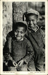 Two African American Boys Smiling By Tree