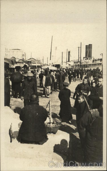 Group of Chinese People near a Dock China