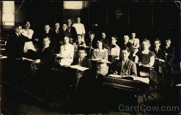 Children and Teacher in a Schoolroom School and Class Photos