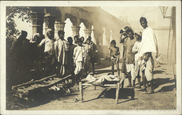 A Burning Ghat -Wood Pile Ready, Deceased Body on Bed Awaiting Ceremony Calcutta India