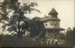 Group of People in Front of Victorian House