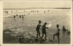 People Playing in the Ocean Water