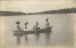 Women and Man in Rowboat on Lake