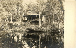 Cabin in the Woods with a Pond and Boat