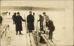Men Cutting Ice on a Lake