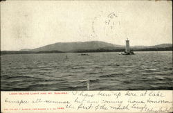 Loon Island Light and Mt. Sunapee