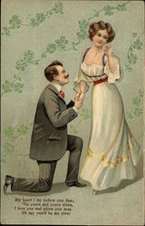 Man on Bended Knee Proposing to Woman in White Dress