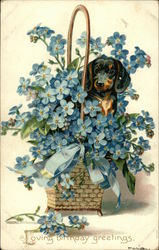 Loving Birthday Greetings - Dog in Large Basket of Blue Flowers