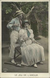 Young Couple with Tennis Rackets