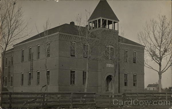 A Brick Schoolhouse with a Bell Tower and Fence Schools & Education