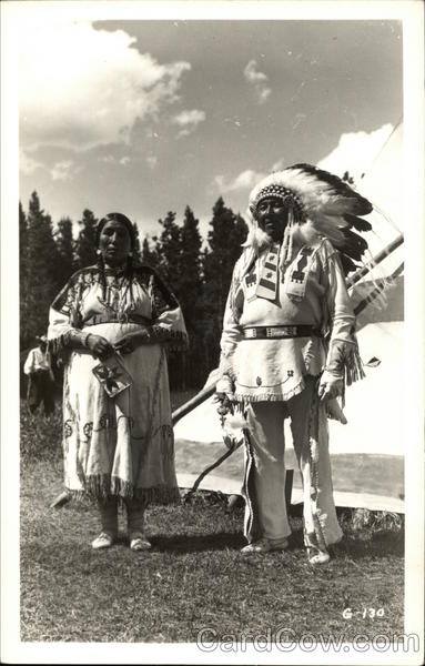 Indian Woman and Chief outside of Tepee Native Americana