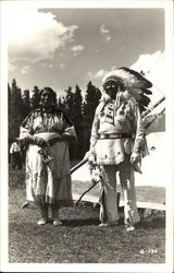 Indian Woman and Chief outside of Tepee