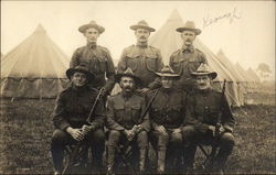 Group of Men in Military at a Camp