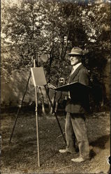 Artist Working at an Easel with a Blank Canvas