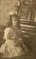 Girl Sitting at Organ