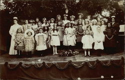 Group of Children on Stage with their Teachers