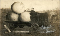 Man Driving Truck with Giant Apples