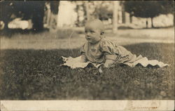 Baby Crawling on a Blanket in the Grass