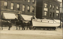 "Horse Team Pulling Boat ""Antler"" Through Town - J.J. Quilty Grocery"