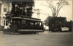 "Main St. Showing Electric Streetcar and Horse-Drawn Boat ""Antler"""