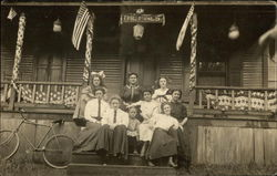Women and Girls Sitting On Patriotically Decorated Porch of The Pines