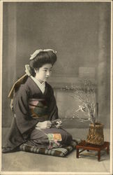Japanese Woman Tending to A Bonzai