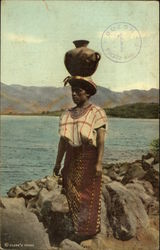 Indian Carrying Water on Head