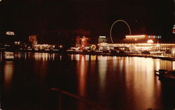Night scene of the Amusement Section at Asbury Park, N.J., with Wesley Lake in the foreground.