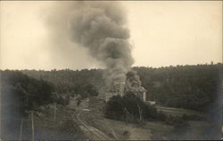 View of Large Building on Fire Near Train Tracks